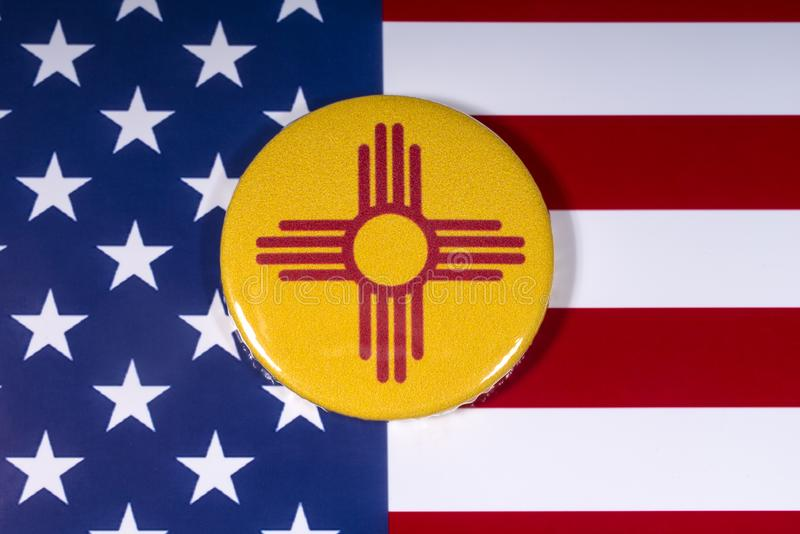 State of New Mexico in the USA. London, UK - November 15th 2018: The symbol of the state of New Mexico, pictured over the flag of the United States of America stock image