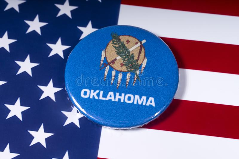 State of Oklahoma in the USA. London, UK - November 15th 2018: The symbol of the state of Oklahoma, pictured over the flag of the United States of America royalty free stock photo