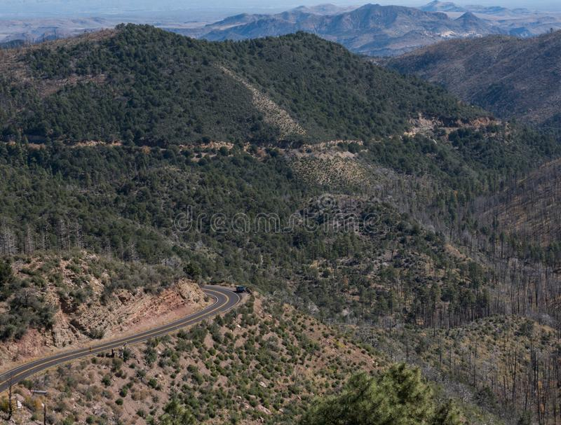 State road 152 in southwest New Mexico. State highway 152 winds it`s way between Hillsboro and Silver city New Mexico. Damage from a past forest fire can also royalty free stock image