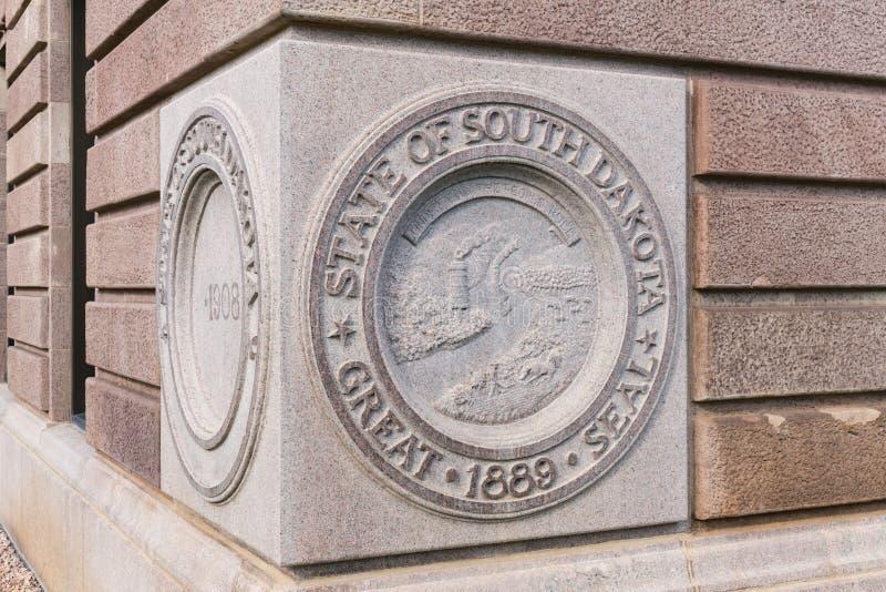 State Seal South Dakota Capital Building. PIERRE, SD - JULY 9, 2018: State Seal of South Dakota on the cornerstone of the Capital Building in Pierre, SD stock photo