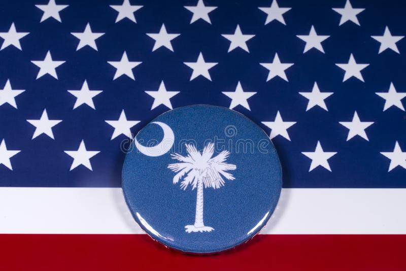 The State of South Carolina. London, UK - November 15th 2018: The symbol of the State of South Carolina, pictured over the flag of the United States of America stock images