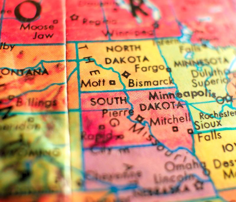 State of South Dakota, USA focus macro shot on globe map for travel blogs, social media, web banners and backgrounds. royalty free stock images