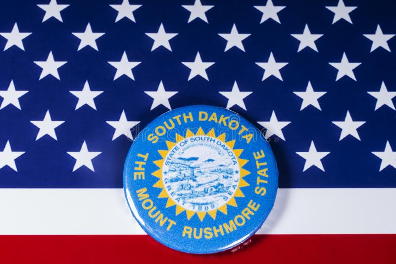 The State of South Dakota in the USA. London, UK - November 20th 2018: The symbol of the State of South Dakota, pictured over the flag of the United States of royalty free stock photography