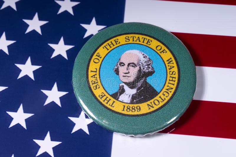 The State of Washington. London, UK - November 15th 2018: A badge portraying the seal of the State of Washington, pictured over the flag of the United States of stock image