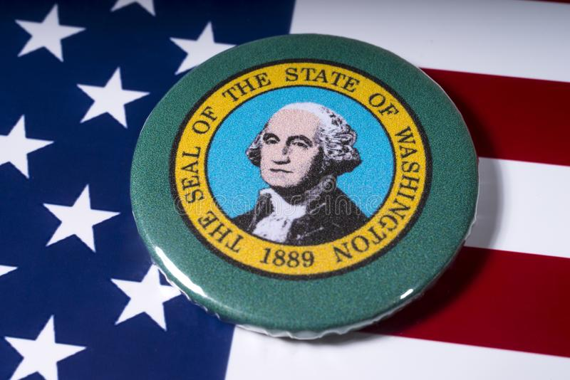 The State of Washington. London, UK - November 15th 2018: A badge portraying the seal of the State of Washington, pictured over the flag of the United States of royalty free stock photos
