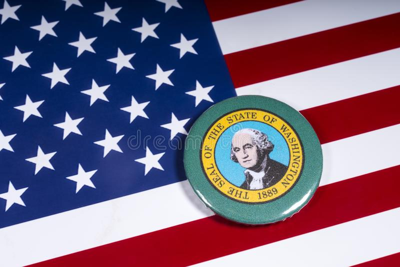 The State of Washington. London, UK - November 15th 2018: A badge portraying the seal of the State of Washington, pictured over the flag of the United States of stock photo