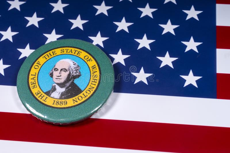 The State of Washington. London, UK - November 15th 2018: A badge portraying the seal of the State of Washington, pictured over the flag of the United States of royalty free stock photography