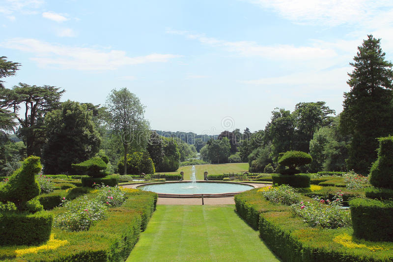 Stately garden leading to a water fountain royalty free stock photos
