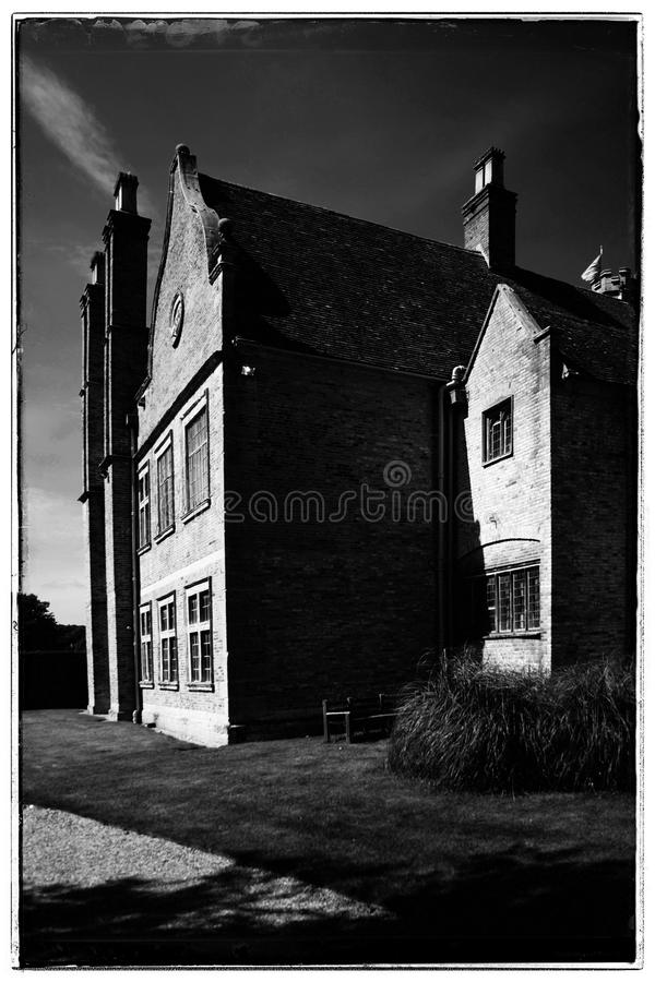 Stately home. Black and white high contrast image of an English country house stately home coughton court Warwickshire Midlands England royalty free stock image