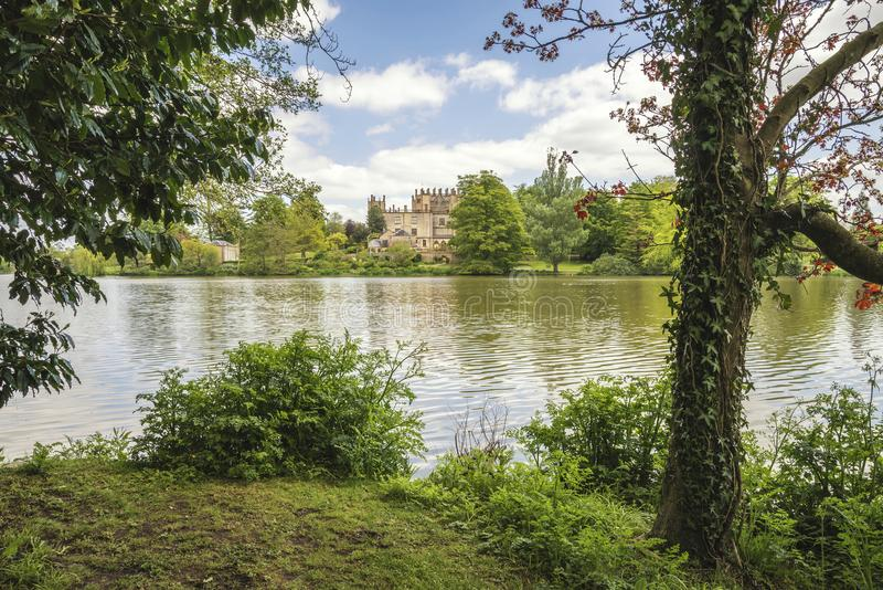 Stately home mansion in landscape on lovely blue sky Summer day. Stately home mansion in landscape on beautiful blue sky Summer day royalty free stock images