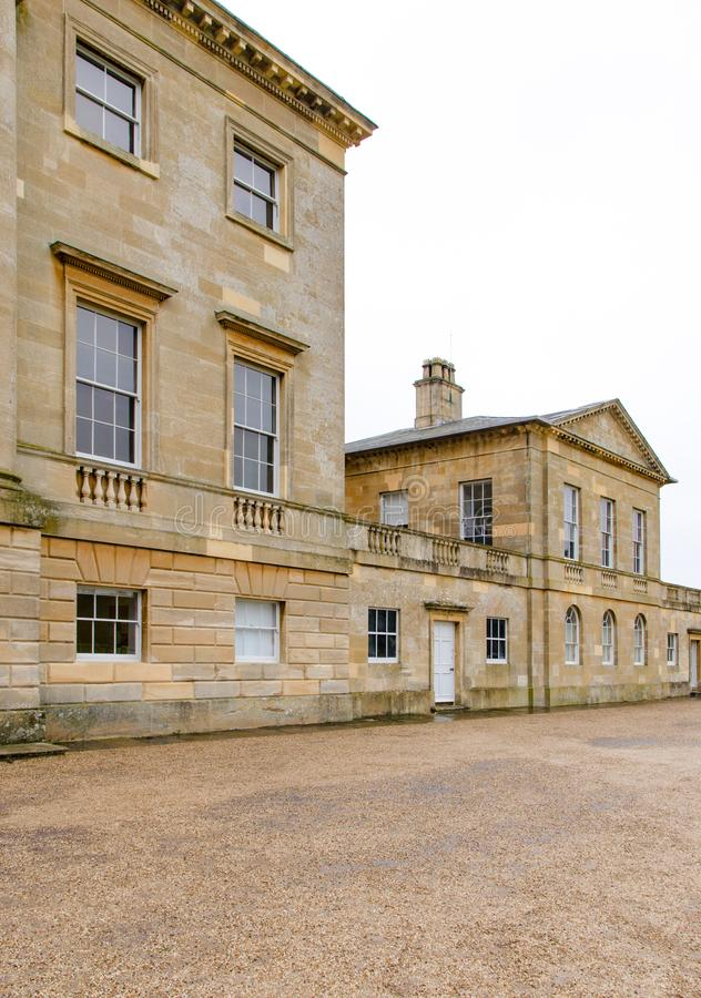 Stately home in rural Britain. Grand stately home in rural Britain owned by the wealthy royalty free stock photos