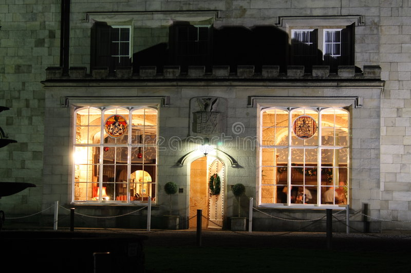 Stately home windows and door lit at night. Old stately home lit up at night and situated in the english countryside stock photo