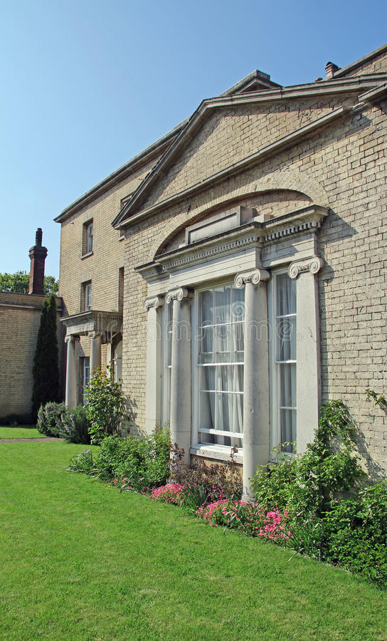 Stately manor house. Photo of a stately manor house with corinthian pillars and well maintained lawns. photo taken on 19th may 2013 stock photos