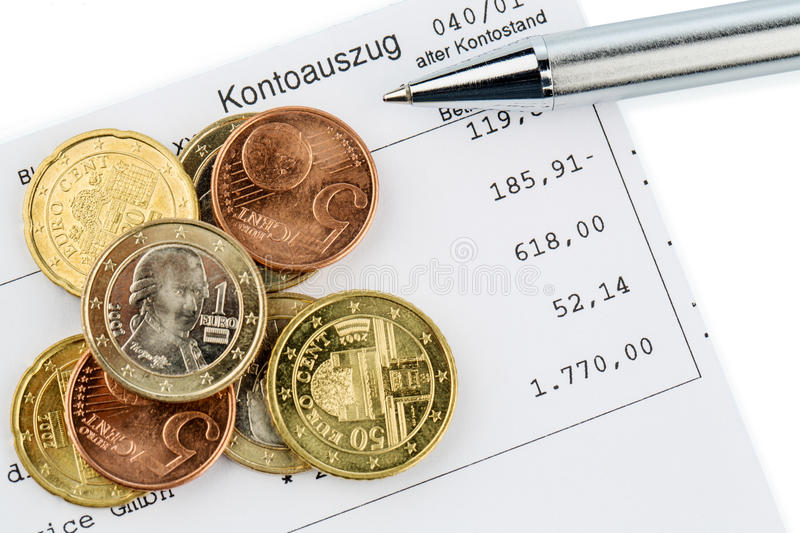 Statement of account and coins. The bank statement and some coins of euro currency stock photo