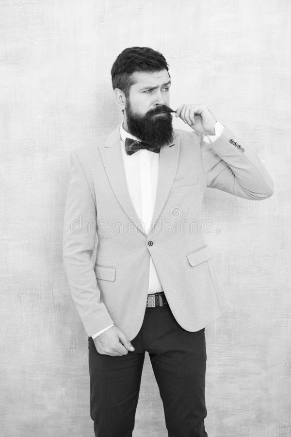 Statement with his stunning crisp suit jacket. Stylist fashion expert. Suit style. Fashion trends for groom. Groom stock image