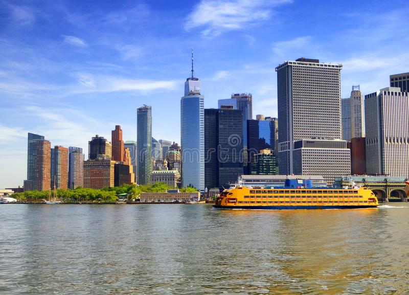 Staten island ferry with Lower Manhattan background. Staten island ferry boating on the sea with lower Manhattan skyline in New York United States stock photos