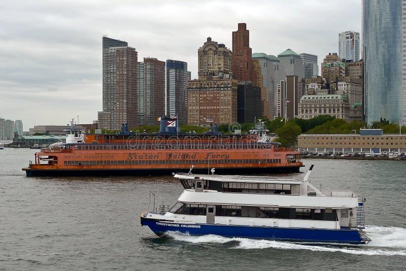 Staten Island and NY Waterway Ferry, New York city. Orange Staten Island Ferry connecting Manhattan with Staten Island, and New York Waterway Ferry, New York stock photography