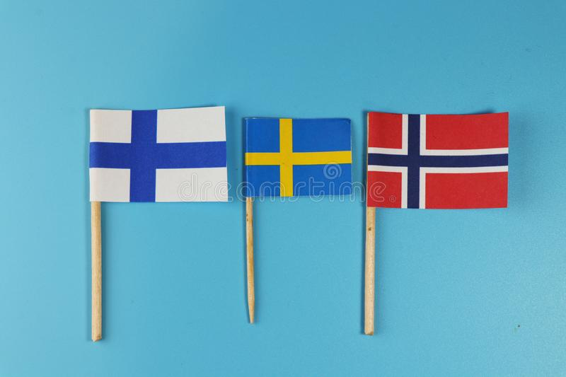 A states of North Europe. Scandinavia states and their flags Norway, Findland and Sweden royalty free stock photo
