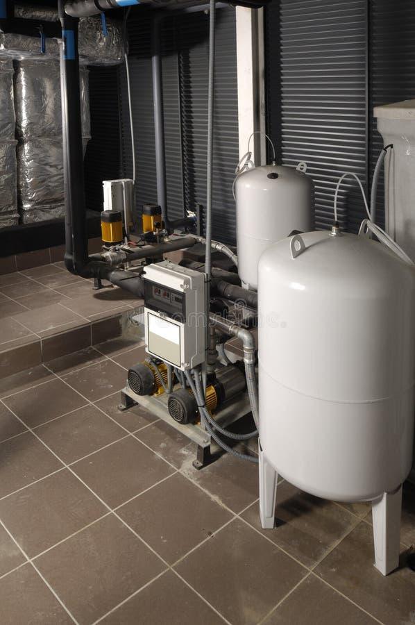 Station de pompage de l'eau et intérieur de maison images libres de droits