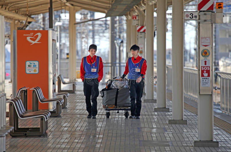STATION STAFF AT MISHIMA STATION IN JAPAN stock photo
