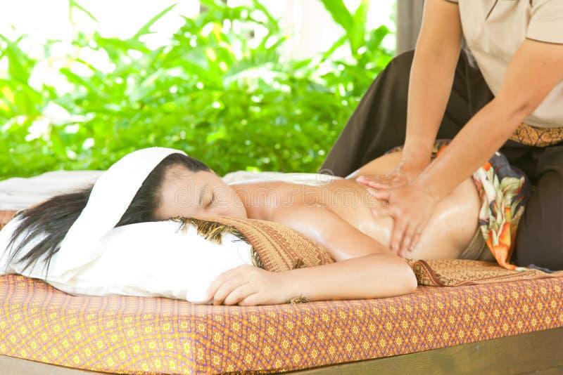 Station thermale arrière de massage de pétrole photos libres de droits