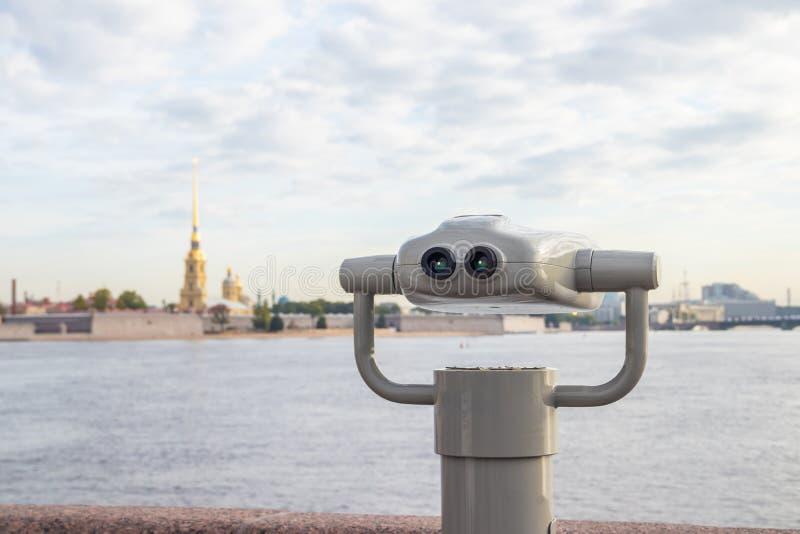 Stationary binoculars. gadgets at viewing platforms. big city binoculars. Watch with binoculars. panorama of the city royalty free stock image