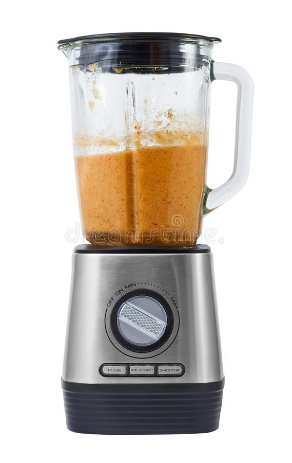 Stationary blender with fruit smoothie royalty free stock photo