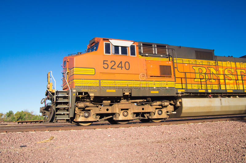 Stationary BNSF Freight Train Locomotive No. 5240 in the desert. Distinctive orange and yellow Burlington Northern Santa Fe Locomotive freight train No. 5240 on royalty free stock photography