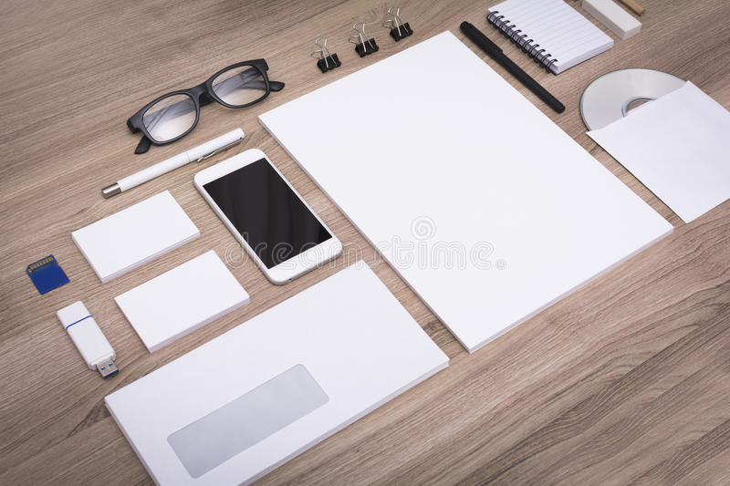 Stationary mockup. On wooden background. Showing different items with no content