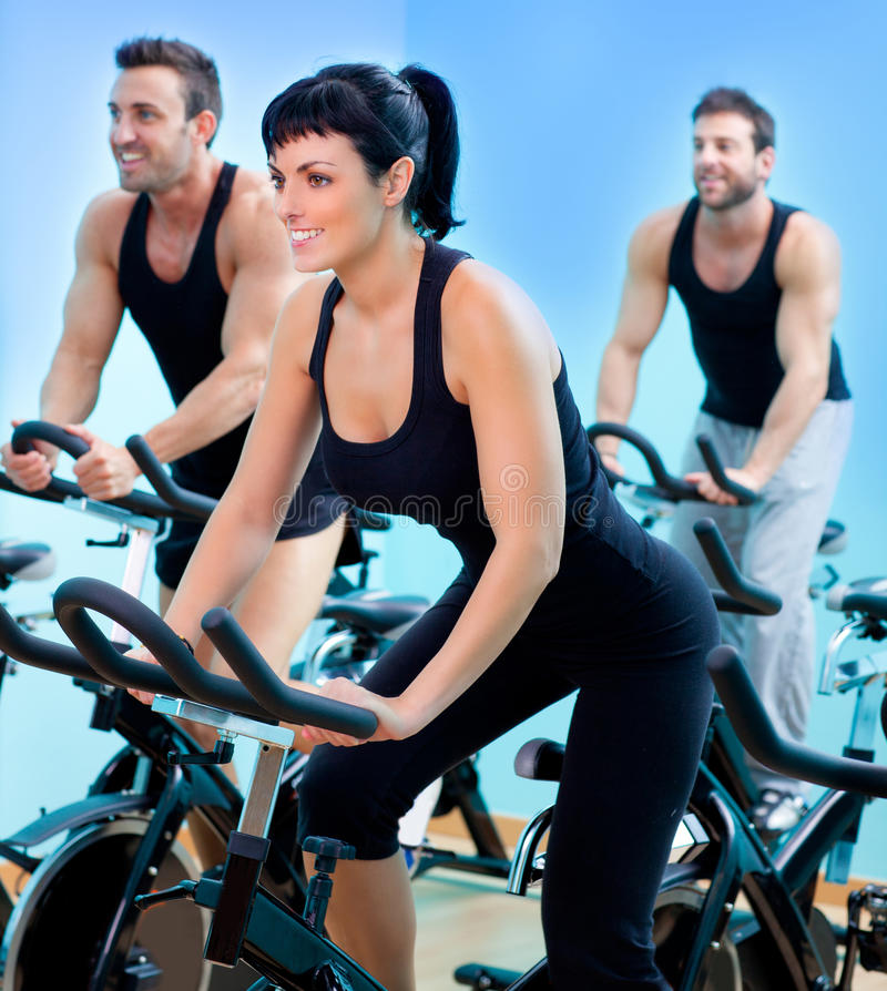 Free Stationary Spinning Bicycles Fitness Girl In A Gym Royalty Free Stock Image - 22843546