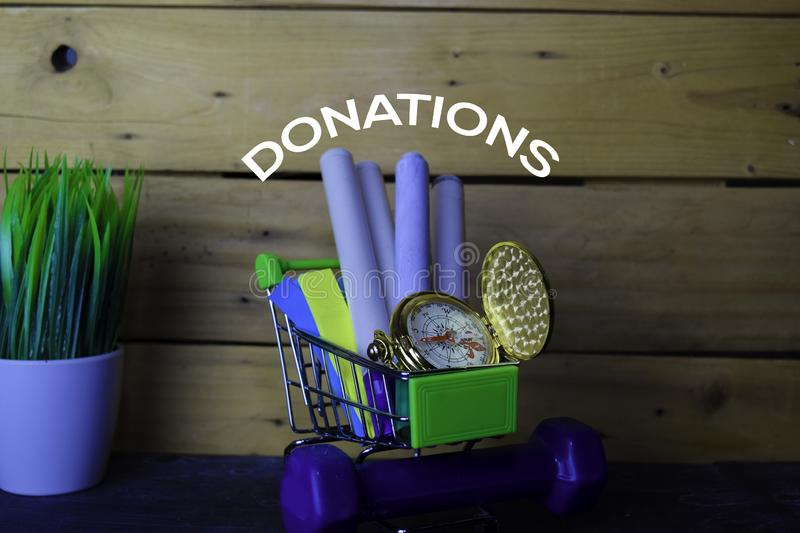 Stationery or Equipment for school in Trolley on wooden table. Donations Concept royalty free stock photos