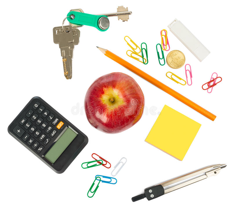 Stationery with fresh apple and keys. On isolated white background royalty free stock photography