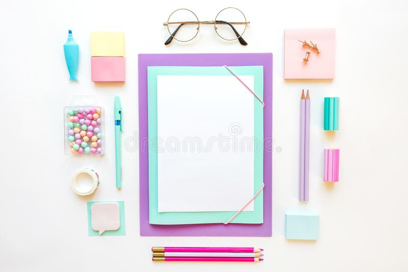 Stationery, girl set in pastel shades. On white background, flatlay, isolated, mock up. Top view. Copy space. Stationery, back to school, girl set in pastel royalty free stock images