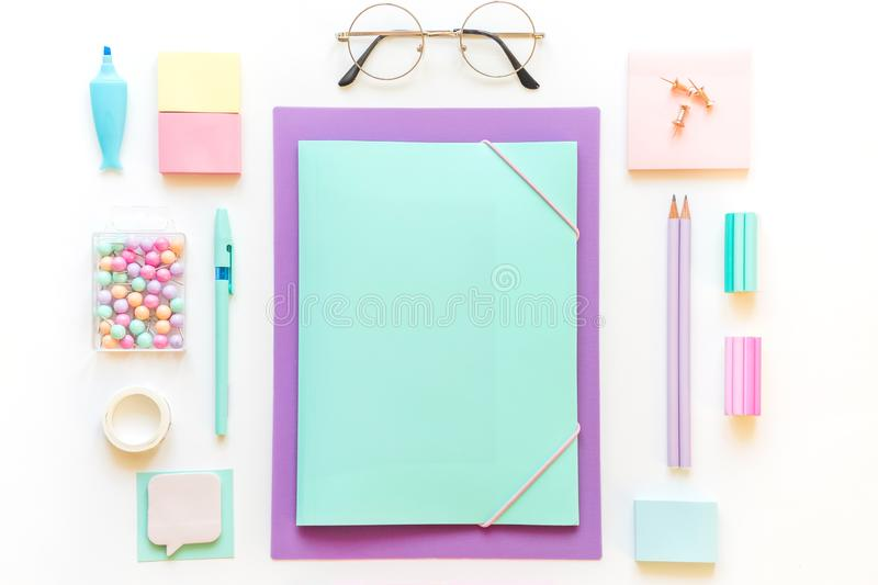 Stationery, girl set in pastel shades. On white background, flatlay, isolated, mock up. Top view. Copy space. Stationery, back to school, girl set in pastel stock photography