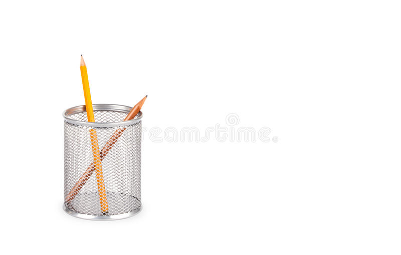Stationery glass on a white background. Stationery glass with pencils on a white background. Basket for pencils royalty free stock images