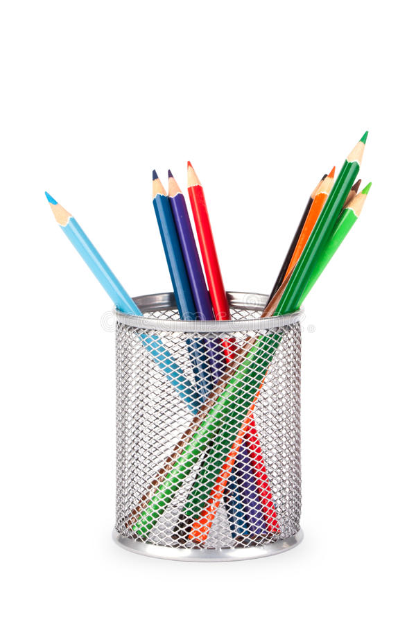 Stationery glass on a white background. Stationery glass with pencils on a white background. Basket for pencils royalty free stock photography