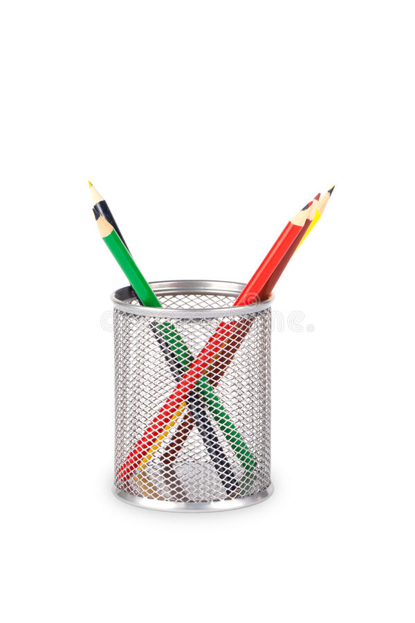 Stationery glass on a white background. Stationery glass with pencils on a white background. Basket for pencils royalty free stock photos