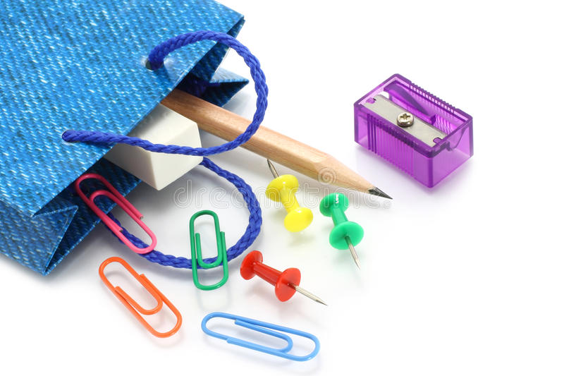 Stationery Items Poured Out From Shopping Bag Royalty Free Stock Photography