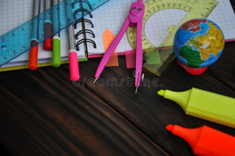 Stationery scattered on a notebook lying on a table royalty free stock images