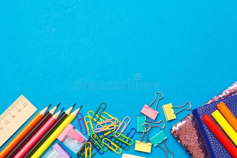 Stationery. School and office supplies on a blue background.Advertising space stock images