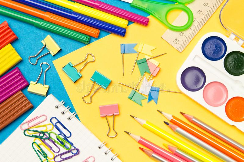 Stationery. School and office supplies on a colored background. Selective focus stock images