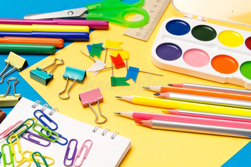 Stationery. School and office supplies on a colored background. Selective focus royalty free stock photos