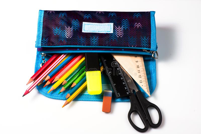 pencil case on a white background. pencils in the pencil case. ruler and scissors. school supplies stock photo