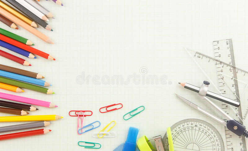 Stationery tool on graph paper. Stationery tools with geometry equipments on graph paper as background stock photo