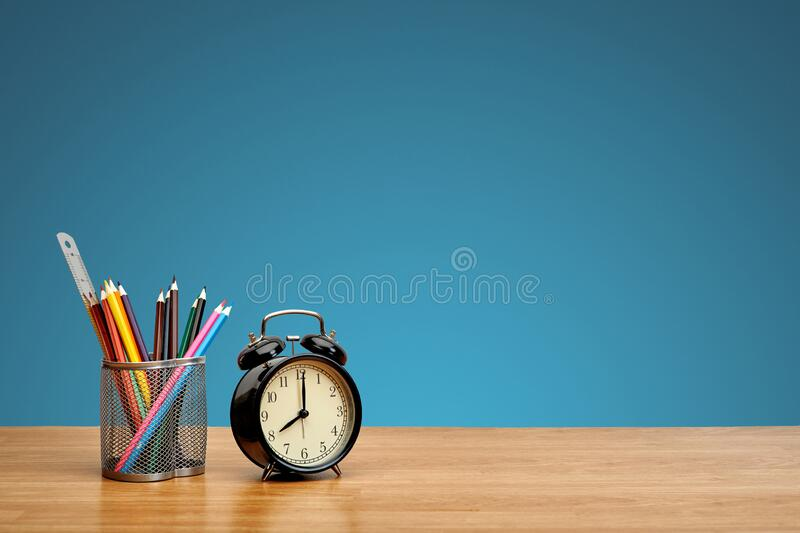 Stationery on wooden table on a blue background, closeup. Copy space. royalty free stock photography