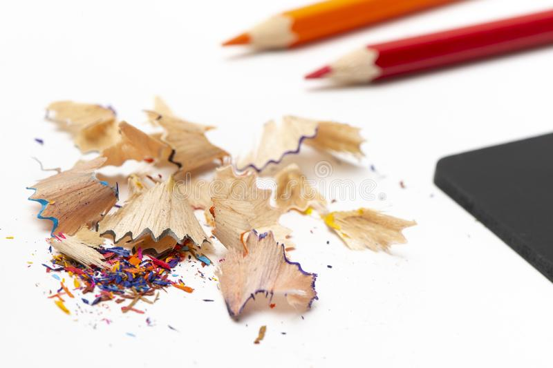 Stationeryset for drawing on white background include crayons, blackboard, sharpener and debris from the sharpening stock photography
