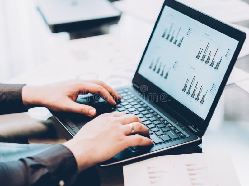 Statistics analysis business man laptop graphs stock photos