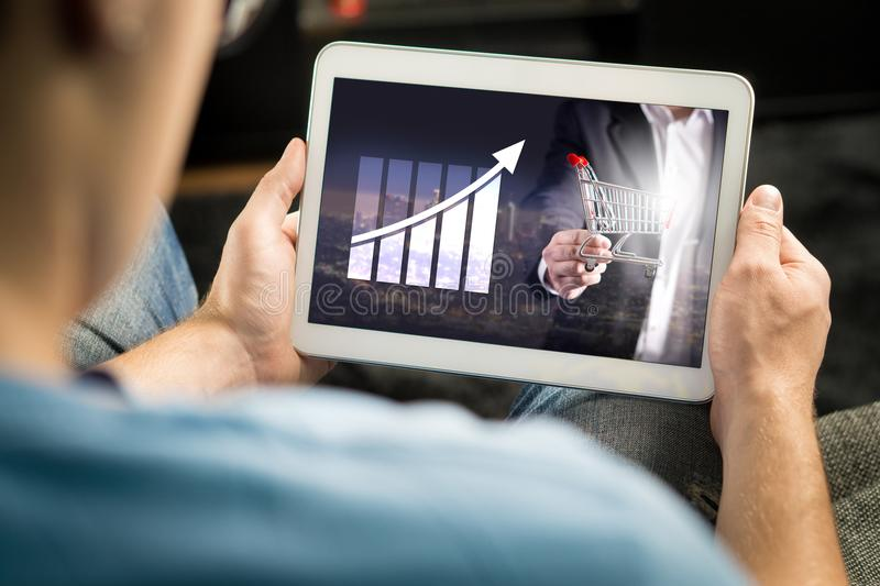 Statistics, analytics and financial report on tablet screen. Success and growth concept. Entrepreneur using business application and doing market analysis with stock image