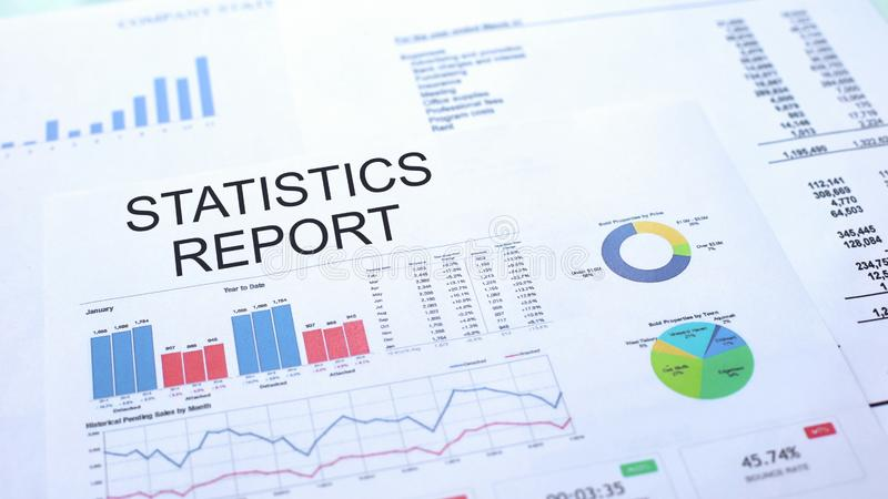 Statistics report lying on table, graphs charts and diagrams, official document. Stock photo royalty free stock photography