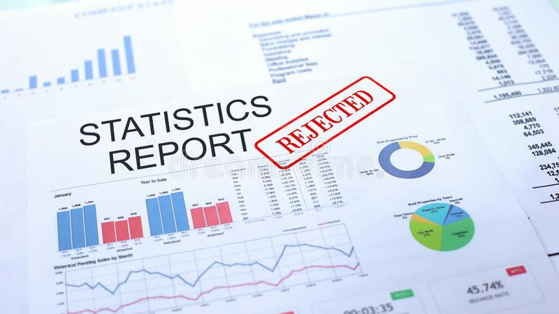 Statistics report rejected, hand stamping seal on official document, statistics. Stock photo royalty free stock photo